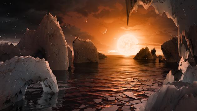 图为艺术家描绘的TRAPPIST-1f地表概念图。这是TRAPPIST-1行星系中的一颗类地行星。